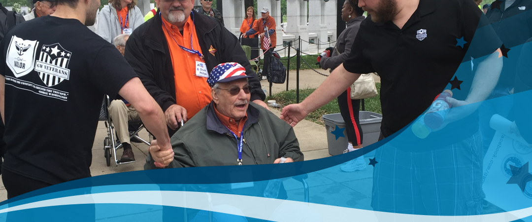 GW Veterans members greet a veteran at an event at the Lincoln